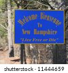 A welcome sign at the New Hampshire state line. - stock photo