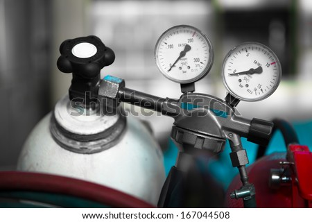 a welding gas cylinder pressure gauge with two - stock photo