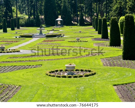 A Well Groomed Park in Early Spring with a Paved Path - stock photo