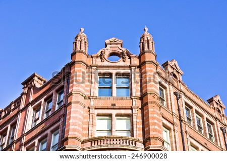 A well maintained red brick building in Manchester, UK - stock photo
