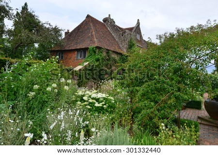 A well stocked overgrown garden in England - stock photo