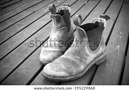 A well worn pair of classic Australian work boots - stock photo