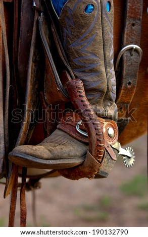 A western riding boot with spur - stock photo