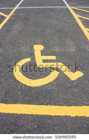 A wheelchair disability sign, signifies a car parking space reserved for disabled. - stock photo