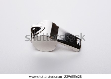 A whistle isolated white at the studio.