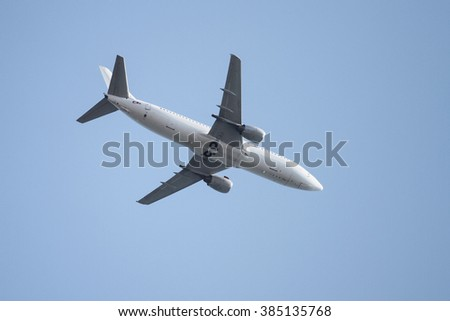 A White Airplane is Landing to Airport - stock photo