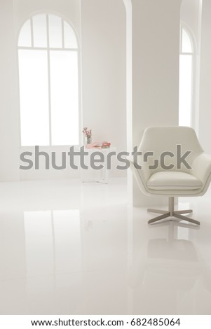 a white armchair put in a music studio