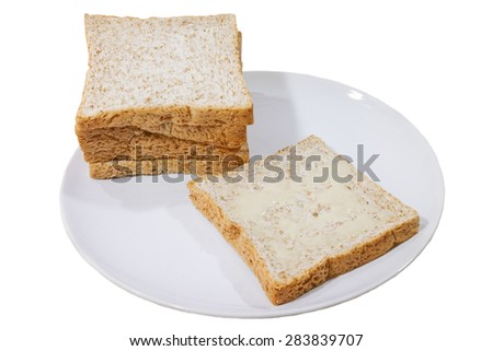 a white background of whole wheat bread on dish.