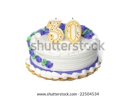 A white birthday cake with a three and a zero candle  on a white background.