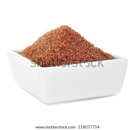 a white bowl with brown sugar on a white background - stock photo