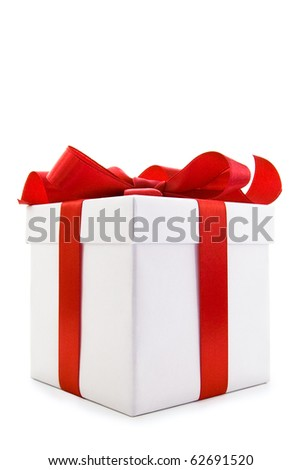 A white box tied with a red satin ribbon bow. A gift for Christmas, Birthday, Wedding, or Valentine's day. Isolated on white with clipping path. - stock photo