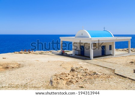 A white chapel on a cliffs of Kavo Greko near Aiya Napa, Cyprus - stock photo