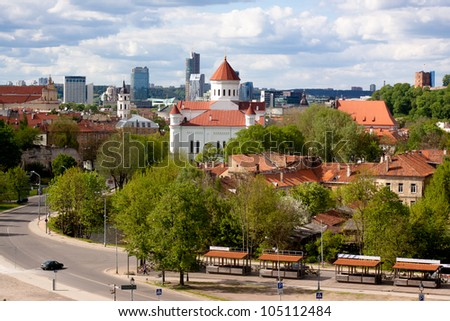 A white church and blue sky in Vilnius - stock photo