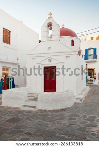 A white church with red roof at Greek town of Mykonos - stock photo