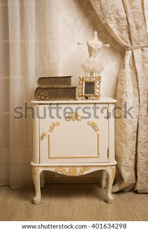 A white dressing table in a vintage style