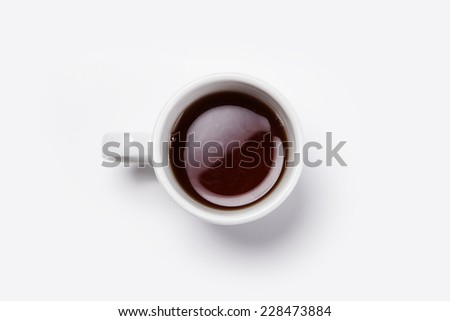 A white espresso cup with coffee isolated white(grey) and top view. - stock photo