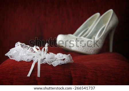 A white garter and shoes. Shallow depth of field.
