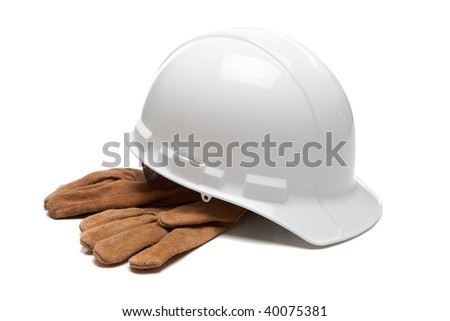 A white hard hat and leather work gloves on a white background - stock photo