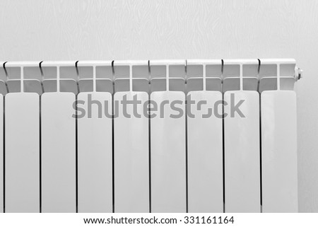 A White heating radiator on the wall - stock photo