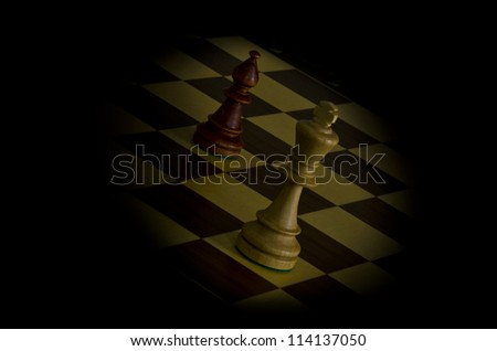 A white King checked by Bishop - stock photo