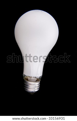 A white light bulb on a black background