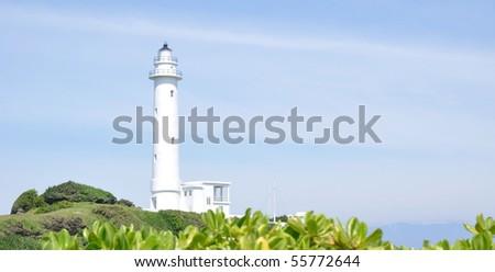 a white lighthouse - stock photo