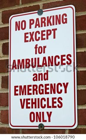 A white No Parking sign near a hospital - stock photo