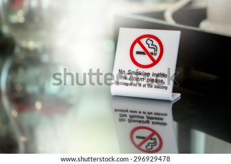 A white no smoking sign displayed on a table in a cafe - stock photo