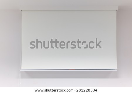 A white overhead projector on ceiling indoors - stock photo