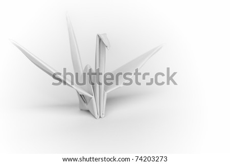 A white paper bird on a white background, shallow depth of field - stock photo