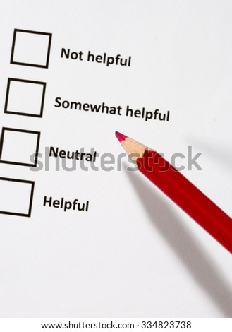A white paper with choices and a red pencil. The survey form is asking was the service personnel helpful for example. Four choices to choose from. The focus point is on the pen tip.