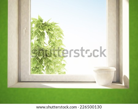 a white pot on the windowsill - stock photo