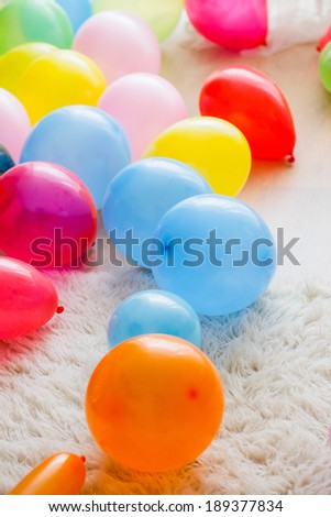 A white rug with color balloons - stock photo