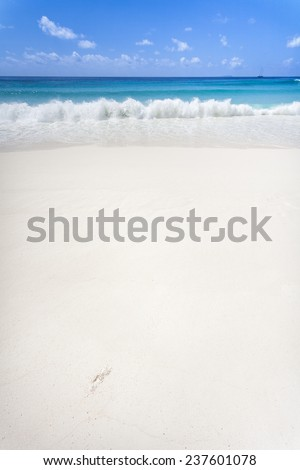A white sandy beach with a lot of copy space. La Digue, Seychelles, Indian Ocean - stock photo