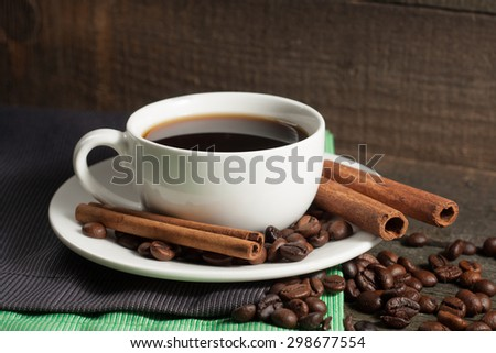 A white set of coffee on wooden and sacking background with cinnamon and coffee beans - stock photo