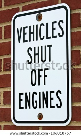 A white sign reading Vehicles Shut Off Engines