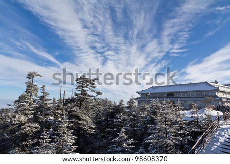 A white temple on the peak with clouds - stock photo