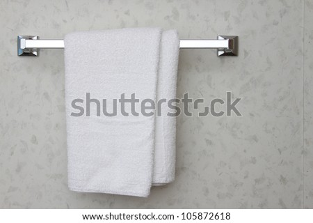 A white towel on a towel rack