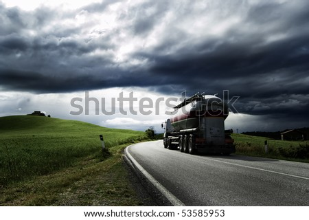 A white truck run on a road - stock photo