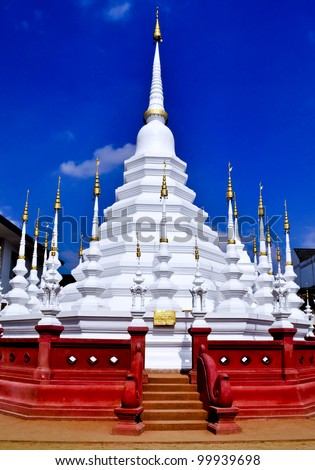 A white wat in Chiang Mai, Thailand with red stairs - stock photo