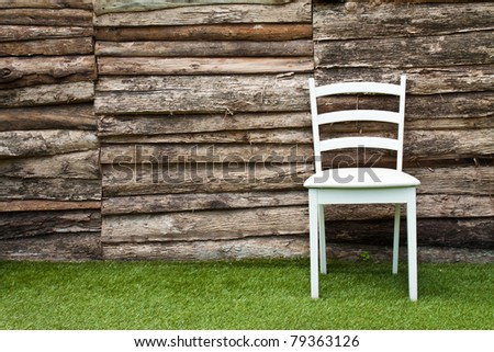 A white wood chair in living room on green grass - stock photo