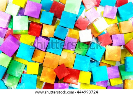 A white wooden blocks on colorful wooden blocks placed together with watercolor techniques. - stock photo