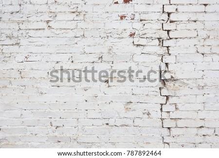 A Whitewashed Brick Wall With Large Vertical Crack Background Of Horizontal Broken Brickwork
