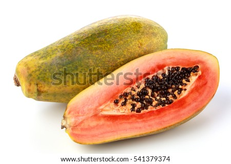 A whole and half of a fresh Papaya against a white background