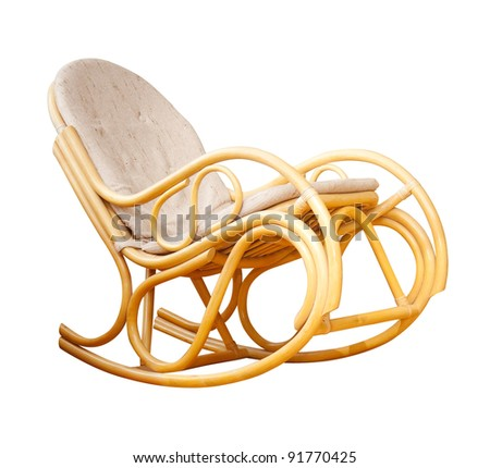 a wicker rocking chair - stock photo