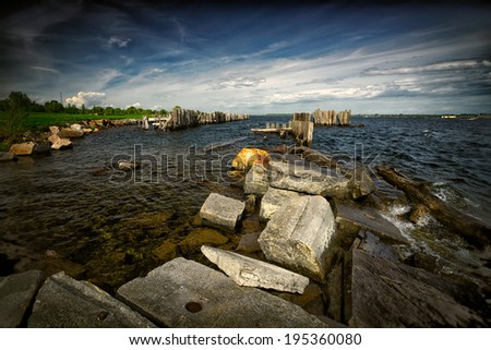 A wide angle image of the rough waters along the coast of the historic St. Lawrence Seaway. Taken from the Ontario, Canada side, New York state, USA is visible on the right, in the distance. - stock photo