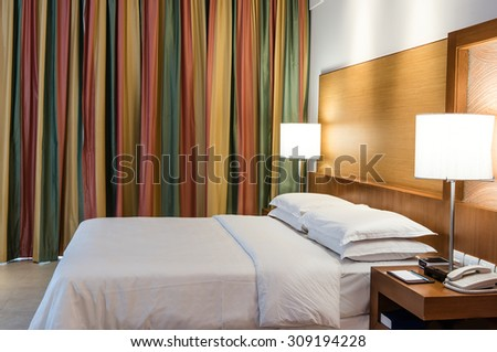 A wide angle view of a hotel room