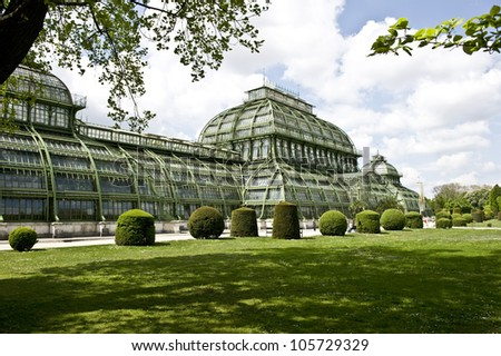 A wide angled color shot of a botanic garden and botanical museum.