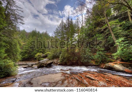 A wild river in Swallow Falls in the Appalachian mountains of Maryland during Autumn - stock photo
