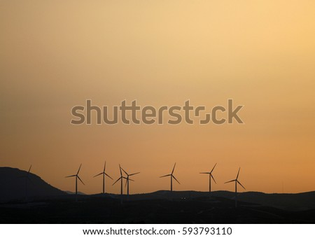 A wind farm is a group of wind turbines in the same location used to produce electricity.A large wind farm may consist of several hundred individual wind turbines .